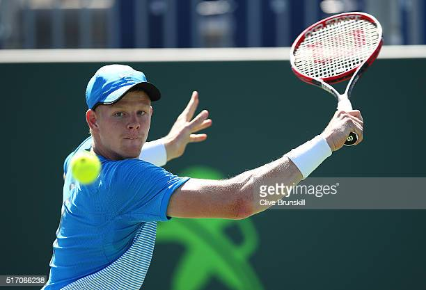 Kyle Edmund of Great Britain plays a backhand against Jiri Vesely of the Czech Republic in their first round match during the Miami Open Presented by...