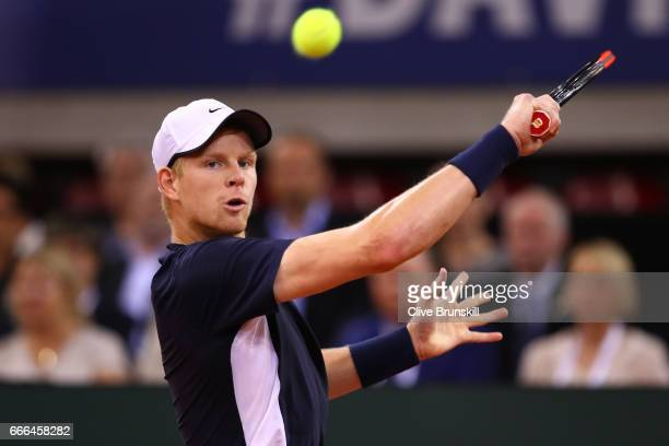 Kyle Edmund of Great Britain plays a backhand in his singles match against Jeremy Chardy of France during day 3 of the Davis Cup World Group...