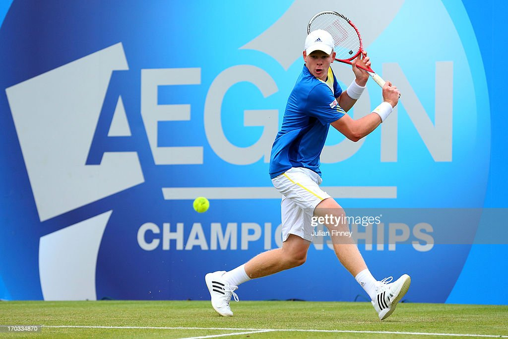Kyle Edmund of Great Britain plays a backhand shot during his Men's Singles first round match against Grega Zemlja of Slovenia on day two of the...