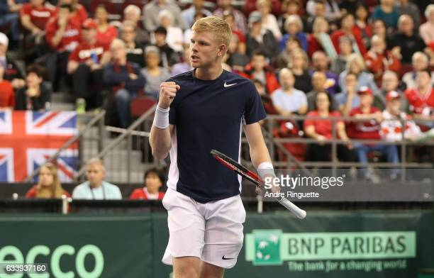Kyle Edmund of Great Britain pumps his fist during his singles match against Denis Shapovalov of Canada on day three of the Davis Cup World Group tie...