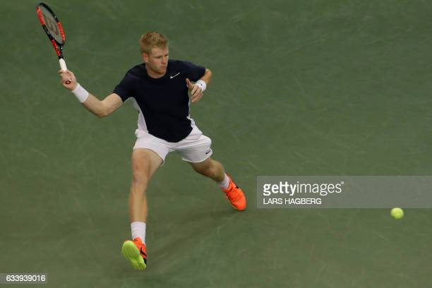 Kyle Edmund of Great Britain reaches for a ball during the first set against Denis Shapovalov of Canada on the third day of Davis Cup first round...