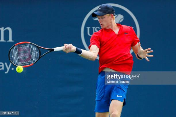 Kyle Edmund of Great Britain returns a shot against Joao Sousa of Portugal during Day 3 of the Western and Southern Open at the Lindner Family Tennis...
