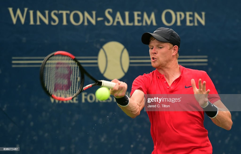 Kyle Edmund of Great Britain returns a shot to Marton Fucsovics of Hungary during the fifth day of the Winston-Salem Open at Wake Forest University on August 23, 2017 in Winston-Salem, North Carolina.