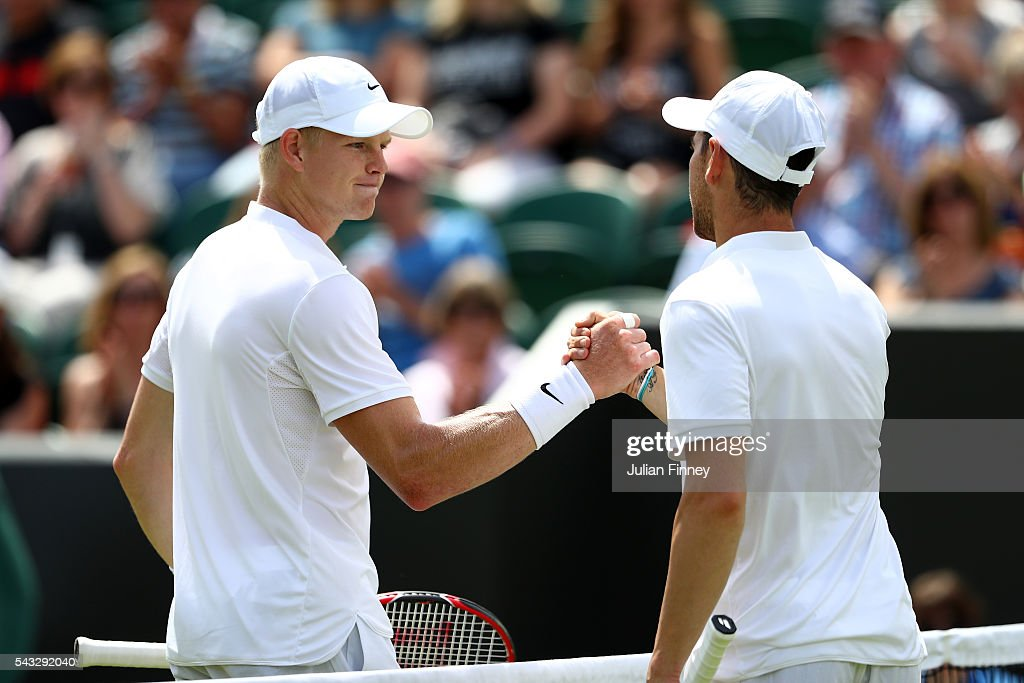 <a gi-track='captionPersonalityLinkClicked' href=/galleries/search?phrase=Kyle+Edmund&family=editorial&specificpeople=7070090 ng-click='$event.stopPropagation()'>Kyle Edmund</a> of Great Britain shakes hands with <a gi-track='captionPersonalityLinkClicked' href=/galleries/search?phrase=Adrian+Mannarino&family=editorial&specificpeople=5361274 ng-click='$event.stopPropagation()'>Adrian Mannarino</a> of France after losing the Men's Singles first round match on day one of the Wimbledon Lawn Tennis Championships at the All England Lawn Tennis and Croquet Club on June 27th, 2016 in London, England.