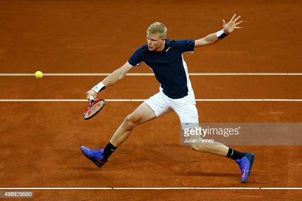 Kyle Edmund of Great Britain volleys during the singles match against David Goffin of Belgium on day one of the Davis Cup Final 2015 at Flanders Expo...