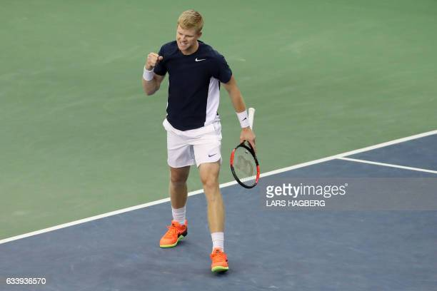 Kyle Edmund of Great Britain wins the first set against Denis Shapovalov of Canada during the third day of Davis Cup first round play between Canada...