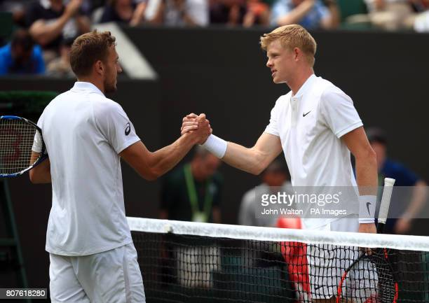 Kyle Edmund shakes hands with fellow Brit Alexander Ward following his victory on day two of the Wimbledon Championships at The All England Lawn...