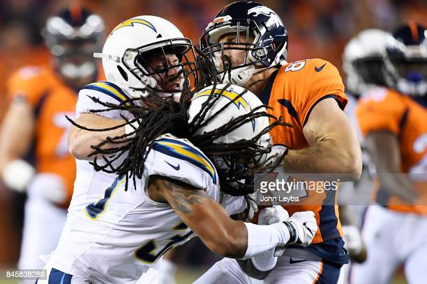 Kyle Emanuel of the Los Angeles Chargers and Tre Boston hit Jeff Heuerman of the Denver Broncos during the first quarter on Monday September 11 2017...