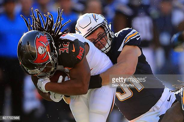 Kyle Emanuel of the San Diego Chargers brings down Jacquizz Rodgers of the Tampa Bay Buccaneers during the first half of a game at Qualcomm Stadium...