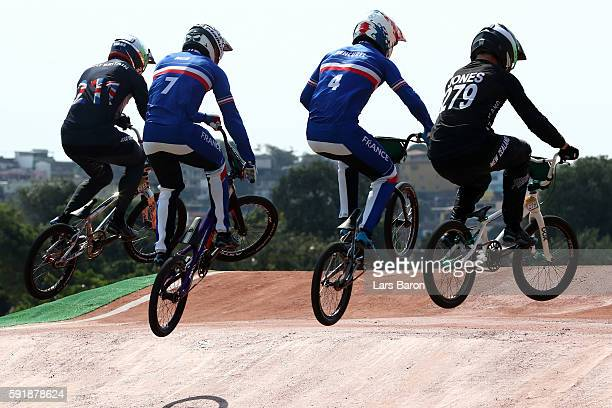 Kyle Evans of Great Britain Amidou Mir of France Jeremy Rencurel of France and Trent Jones of New Zealand competes in the Cycling BMX Men's...