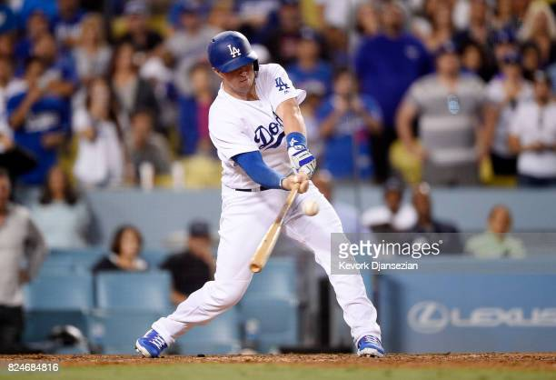Kyle Farmer of the Los Angeles Dodgers hits the game winning double in his Major League at bat against the San Francisco Giants during the 11th...