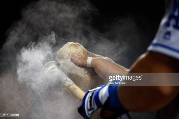 Kyle Farmer of the Los Angeles Dodgers uses a rosin bad on his bat during the ninth inning against the New York Mets at Citi Field on August 6 2017...