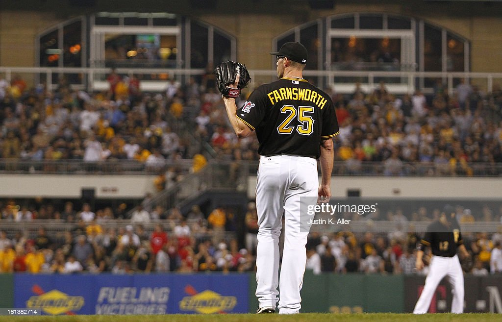 <a gi-track='captionPersonalityLinkClicked' href=/galleries/search?phrase=Kyle+Farnsworth&family=editorial&specificpeople=162760 ng-click='$event.stopPropagation()'>Kyle Farnsworth</a> #25 of the Pittsburgh Pirates reacts after giving up a home run to Joey Votto (not pictured) of the Cincinnati Reds in the 10th inning during the game on September 20, 2013 at PNC Park in Pittsburgh, Pennsylvania.
