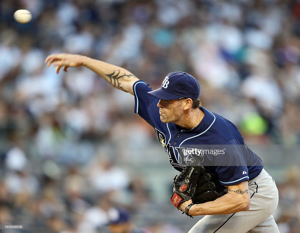 <a gi-track='captionPersonalityLinkClicked' href=/galleries/search?phrase=Kyle+Farnsworth&family=editorial&specificpeople=162760 ng-click='$event.stopPropagation()'>Kyle Farnsworth</a> #43 of the Tampa Bay Rays delivers a pitch against the New York Yankees on September 15, 2012 at Yankee Stadium in the Bronx borough of New York City.