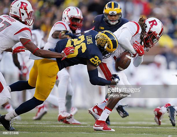 Kyle Federico of the Rutgers Scarlet Knights fumbles a first quarter kick return while being tackled by Jourdan Lewis of the Michigan Wolverines on...