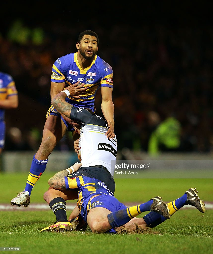 Kyle Feldt of North Queensland Cowboys is tackled by Kallum Watkins and Brad Singleton of Leeds Rhinos during the World Club Series match between...