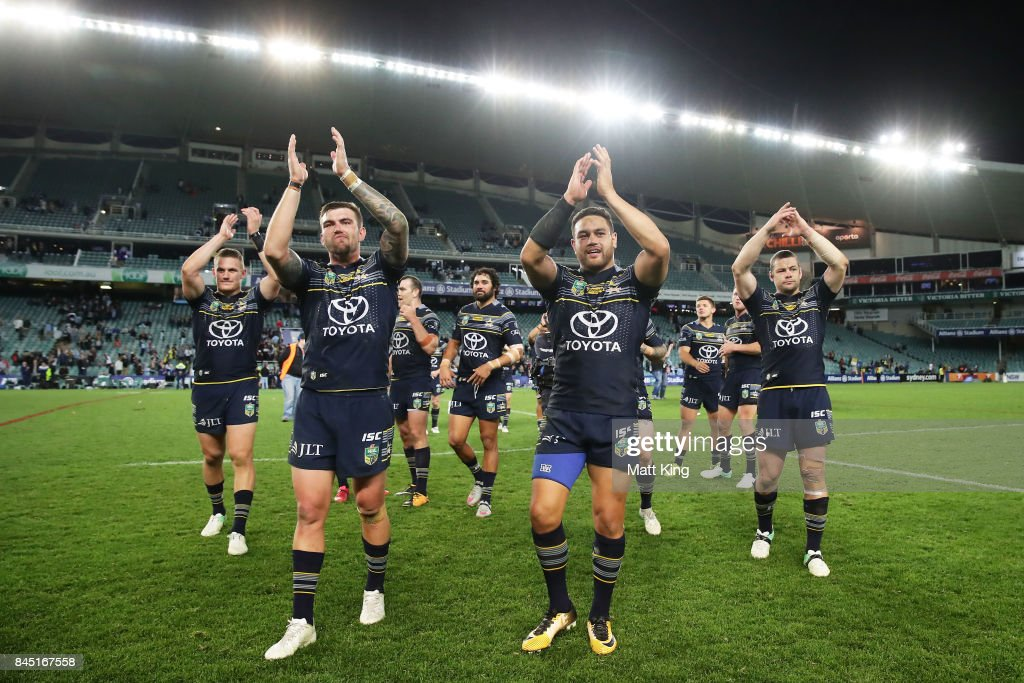 Kyle Feldt of the Cowboys (L) and Antonio Winterstein of the Cowboys (R) celebrate victory at the end of during the NRL Elimination Final match between the Cronulla Sharks and the North Queensland Cowboys at Allianz Stadium on September 10, 2017 in Sydney, Australia.