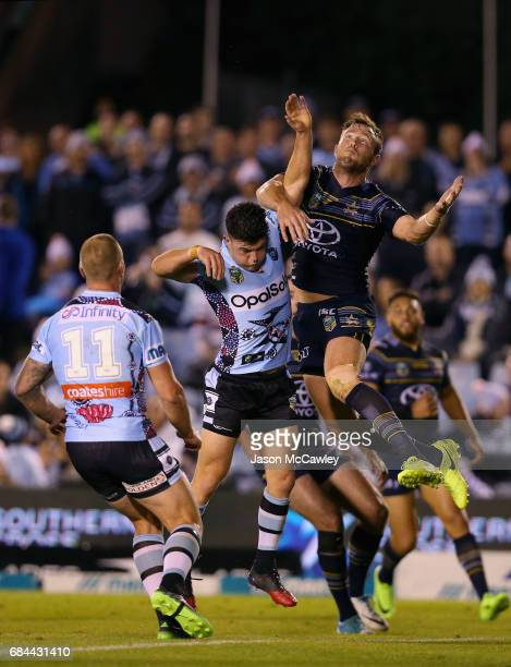 Kyle Feldt of the Cowboys and Chad Townsend of the Sharks compete for the ball during the round 11 NRL match between the Cronulla Sharks and the...