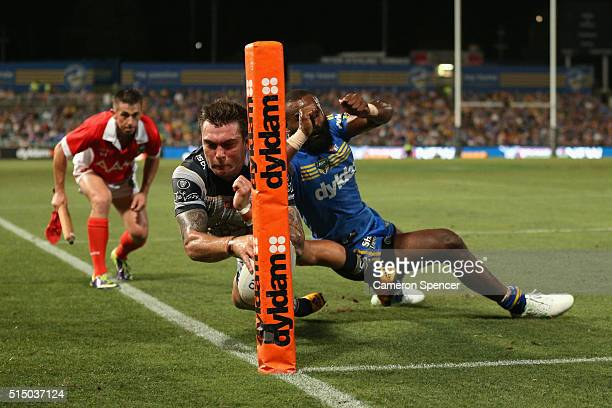 Kyle Feldt of the Cowboys attempts to score a try during the round two NRL match between the Parramatta Eels and the North Queensland Cowboys at...