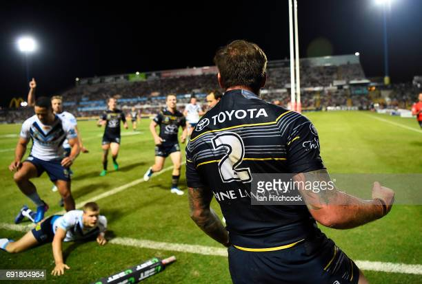 Kyle Feldt of the Cowboys celebrates after scoring a try during the round 13 NRL match between the North Queensland Cowboys and the Gold Coast Titans...