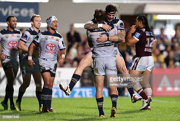 Kyle Feldt of the Cowboys celebrates with his team mates after scoring a try during the round nine NRL match between the Manly Sea Eagles and the...