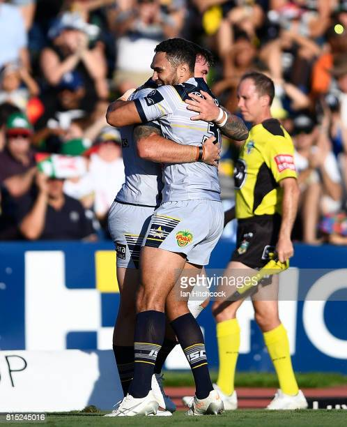 Kyle Feldt of the Cowboys celebrates with Justin O'Neil of the Cowboys after scoring a try during the round 19 NRL match between the South Sydney...