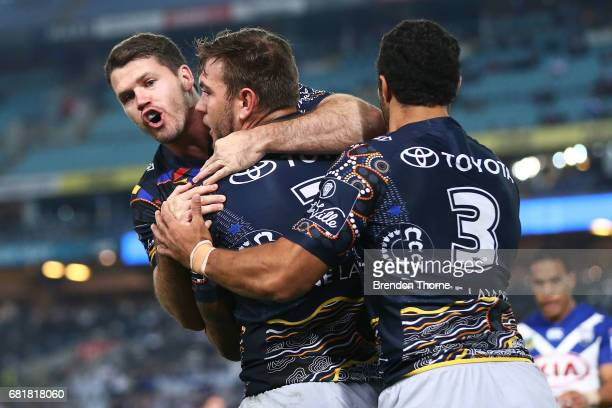 Kyle Feldt of the Cowboys celebrates with team mates after scoring a try during the round 10 NRL match between the Canterbury Bulldogs and the North...