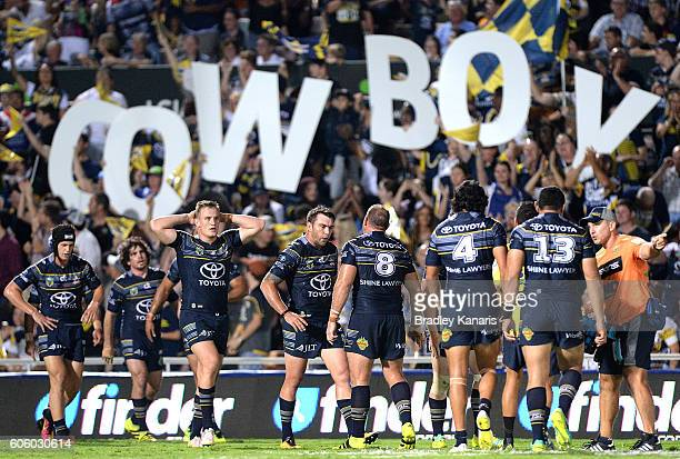 Kyle Feldt of the Cowboys is congratulated by team mates after scoring a try during the first NRL semi final between North Queensland Cowboys and...