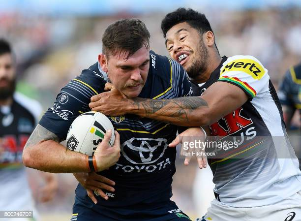Kyle Feldt of the Cowboys is tackled by Waqa Blake of the Panthers during the round 16 NRL match between the North Queensland Cowboys and the Penrith...