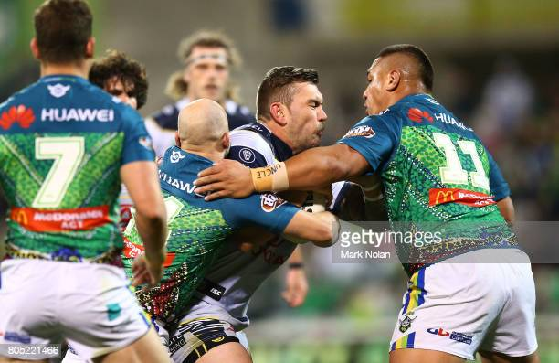 Kyle Feldt of the Cowboys is tackled during the round 17 NRL match between the Canberra Raiders and the North Queensland Cowboys at GIO Stadium on...