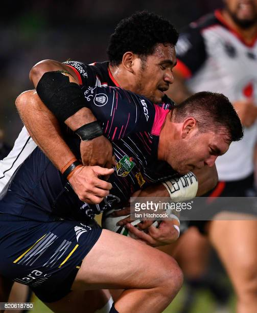 Kyle Feldt of the Cowboys is tackled during the round 20 NRL match between the North Queensland Cowboys and the New Zealand Warriors at 1300SMILES...