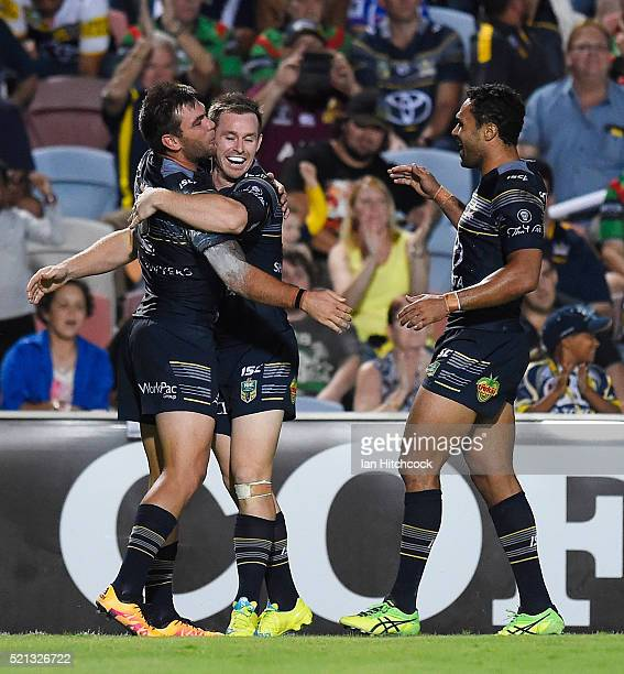 Kyle Feldt of the Cowboys kisses Michael Morgan of the Cowboys after scoring a try during the round seven NRL match between the North Queensland...