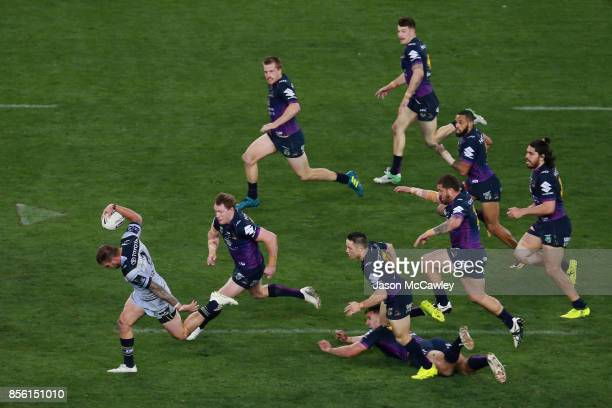 Kyle Feldt of the Cowboys makes a break during the 2017 NRL Grand Final match between the Melbourne Storm and the North Queensland Cowboys at ANZ...