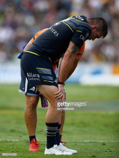 Kyle Feldt of the Cowboys receives treatment after being injured during the round 16 NRL match between the North Queensland Cowboys and the Penrith...