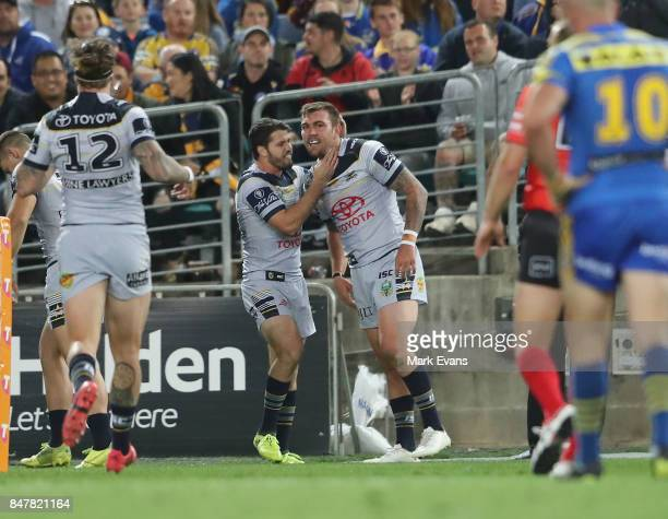 Kyle Feldt of the Cowboys right celebrates a try with Lachlan Coote during the NRL Semi Final match between the Parramatta Eels and the North...