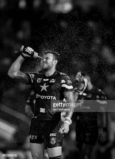 Kyle Feldt of the Cowboys sprays himself with water during the round five NRL match between the North Queensland Cowboys and the South Sydney...