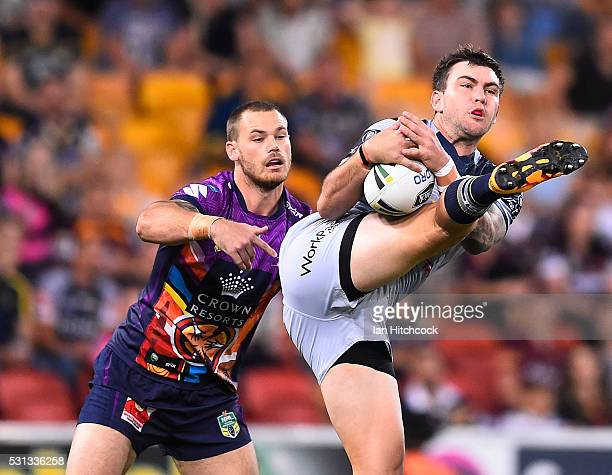 Kyle Feldt of the Cowboys takes a high ball in front of Cheyse Blair of the Storm during the round 10 NRL match between the Melbourne Storm and the...