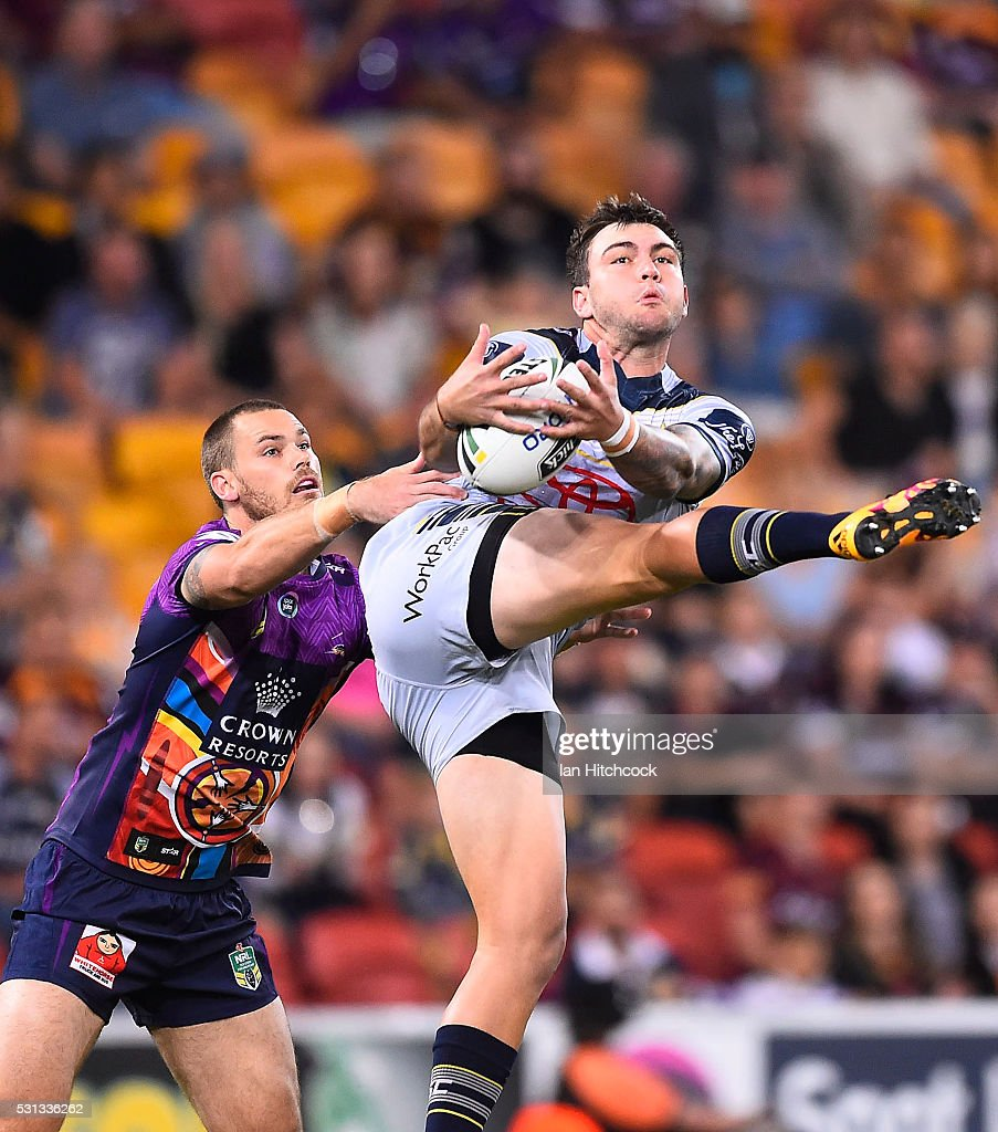 Kyle Feldt of the Cowboys takes a high ball in front of Cheyse Blair of the Storm during the round 10 NRL match between the Melbourne Storm and the North Queensland Cowboys at Suncorp Stadium on May 14, 2016 in Brisbane, Australia.