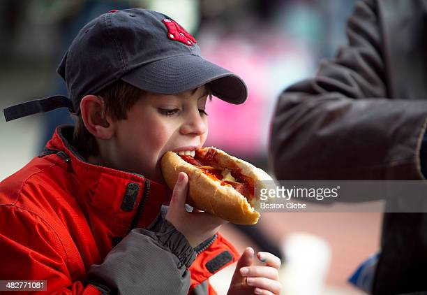 Kyle Fitch of Arlington bit into a Monster Dog during the Boston Red Sox's home opener against the Milwaukee Brewers at Fenway Park on Friday April 4...
