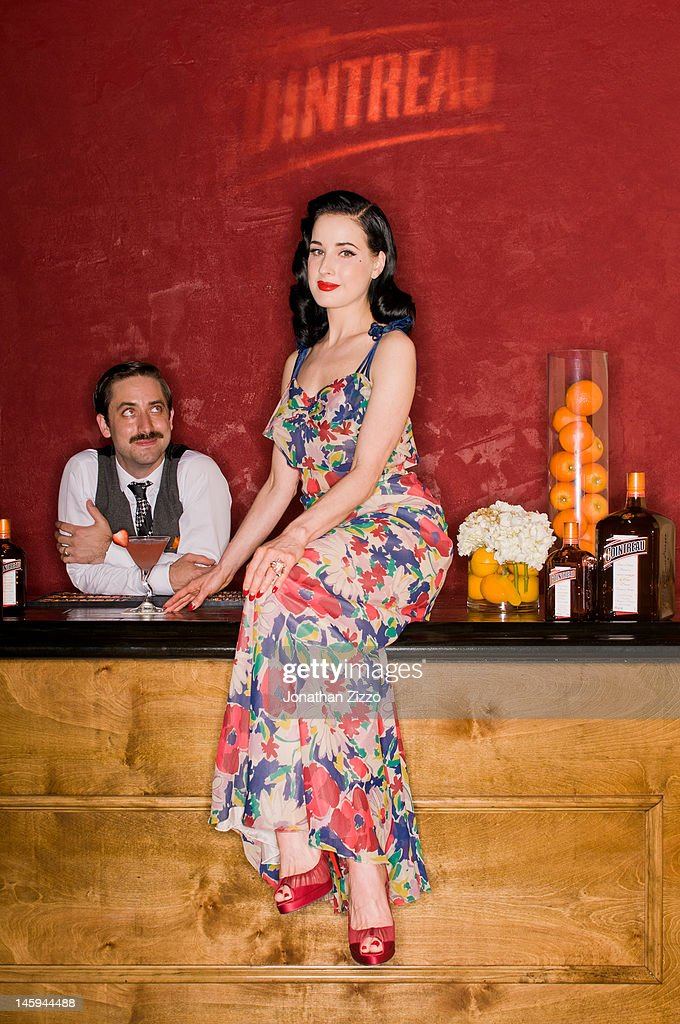 Kyle Ford and Dita Von Teese pose at the Cointreau and Dita Von Teese Launch Summer Bar Cart Cocktail Program at Poolside Soiree on June 7, 2012 at Ku De Ta in Dallas, Texas.
