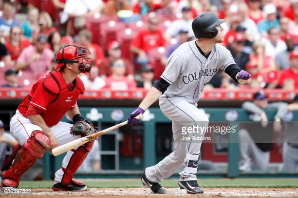 Kyle Freeland of the Colorado Rockies hits a double to left field in the third inning of a game against the Cincinnati Reds at Great American Ball...