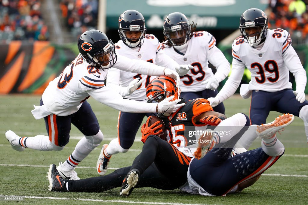 Kyle Fuller #23 and the Chicago Bears tackle Giovani Bernard #25 of the Cincinnati Bengals during the second half at Paul Brown Stadium on December 10, 2017 in Cincinnati, Ohio.