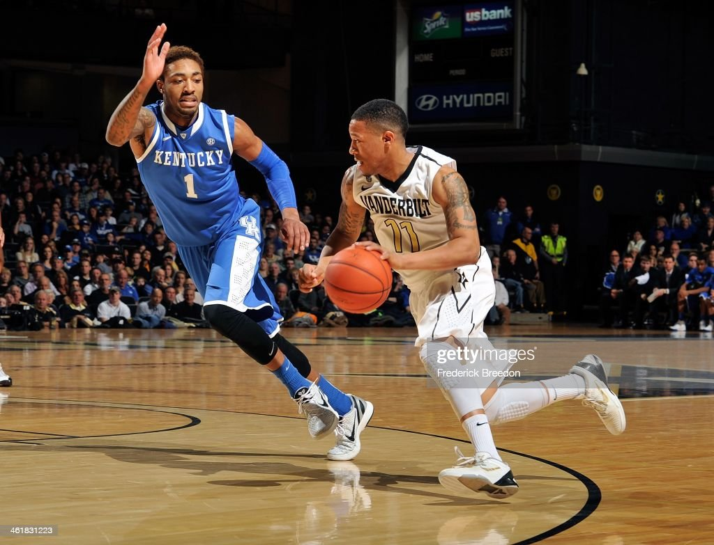 Kyle Fuller #11 of the Vanderbilt Commodores drives against James Young #1 of the Kentucky Wildcats at Memorial Gym on January 11, 2014 in Nashville, Tennessee.