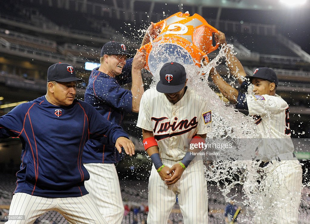 Kyle Gibson #44 and the batboy, Dominic Frost, of the Minnesota Twins pour water on Eddie Rosario #20 as Rudy Hernandez gets out of the way after a win against the Oakland Athletics on May 6, 2015 at Target Field in Minneapolis, Minnesota. The Twins defeated Athletics 13-0.
