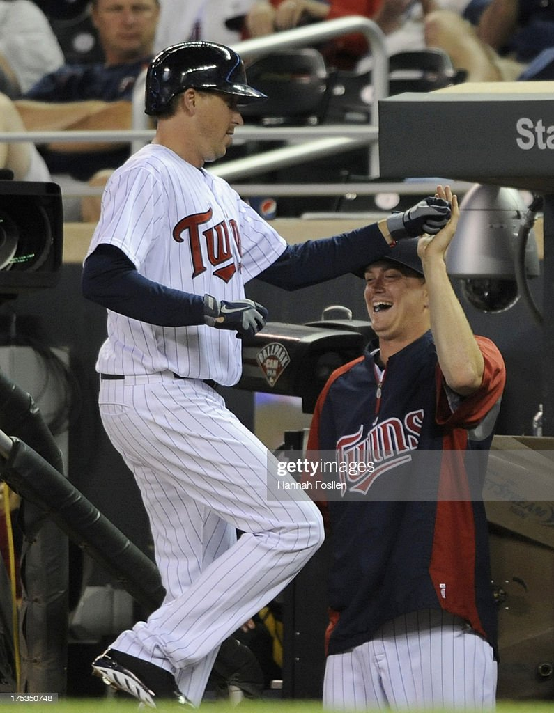 Kyle Gibson #44 of the Minnesota Twins congratulates fellow starting pitcher Kevin Correia #30 on a sacrifice bunt during the thirteenth inning of the game against the Houston Astros on August 2, 2013 at Target Field in Minneapolis, Minnesota. The Twins defeated the Astros 4-3 in thirteen inning.