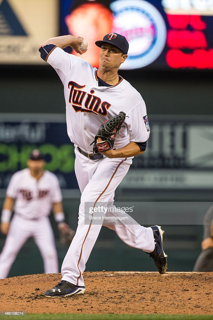 Kyle Gibson of the Minnesota Twins pitches against the Texas Rangers on August 11 2015 at Target Field in Minneapolis Minnesota The Twins defeated...