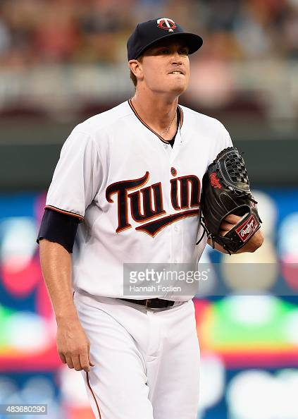 Kyle Gibson of the Minnesota Twins reacts during the second inning of the game against the Texas Rangers on August 11 2015 at Target Field in...