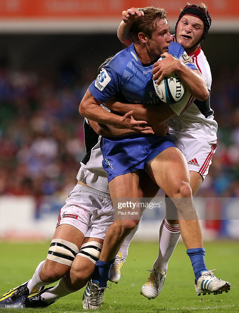Kyle Godwin of the Force gets tackled by <a gi-track='captionPersonalityLinkClicked' href=/galleries/search?phrase=George+Whitelock&family=editorial&specificpeople=4532140 ng-click='$event.stopPropagation()'>George Whitelock</a> and Tyler Bleyendaal of the Crusaders during the round 9 Super Rugby match between the Western Force and the Crusaders at nib Stadium on April 13, 2013 in Perth, Australia.