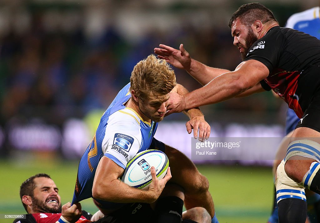 Kyle Godwin of the Force gets tackled during the round 10 Super Rugby match between the Force and the Bulls at nib Stadium on April 29, 2016 in Perth, Australia.
