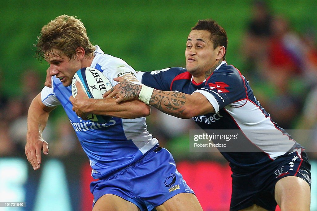 Kyle Godwin of the Force is tackled by Richard Kingi of the Rebels during the round one Super Rugby match between the Rebels and the Force at AAMI Park on February 15, 2013 in Melbourne, Australia.